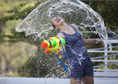 Funny girl under water splashing — Stock Photo