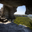 Stock Photo: Lookout from cave and stairs inside
