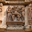 Couple love in temple, Khajuraho, India - Stock Photo