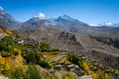 Snow peak mountains with village in front, Nepal — Stock Photo