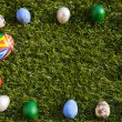 Colorful egg frame on the grass — Stock Photo