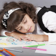 Cute girl sleep with her colorful drawing — Stock Photo