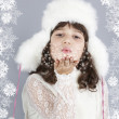 Cute girl white dressing blow snowflakes winter — Stock Photo #32164917