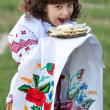 Stock Photo: Cute girl invite to try national dish vareniki