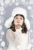 Cute girl white dressing blow snowflakes winter — Stock Photo