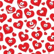 Seamless background of smiling hearts — Stock Vector