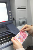 Female hand on ATM — Stockfoto
