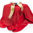 3d gift box under red cloth  — Stock Photo