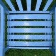 Stock Photo: Rain drop patterns on garden chair