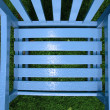 Rain drop patterns on garden chair — Stock Photo