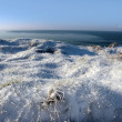 Frosty snow covered grass ditch view - Stock Photo