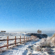 Stock Photo: Fenced walk to ballybunion castle in blizzard