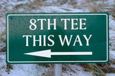 8th tee this way sign on a links golf course — Stock Photo
