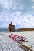 Winters view of ballybunion castle and red benches — Stock Photo