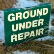 Ground under repair sign on snow covered links golf course - Stock Photo