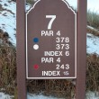 Stock Photo: Seventh tee sign on snow covered links golf course