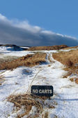 No carts sign on a snow covered links golf course — Stock Photo