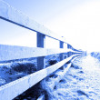 Cold snow covered path on cliff fenced walk — Stock Photo