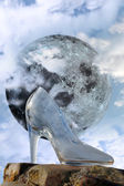 Glass high heel slipper with full moon at midnight — Stock Photo
