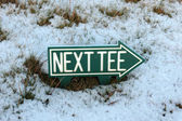 Next tee sign in snow — Stock Photo