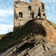 Ballybunion castle ruin on a curvy rock face — Stock Photo