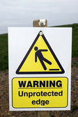 Unprotected edge warning sign with clipping path — Stock Photo
