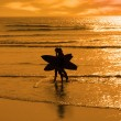 Angelic surfing couple silhouette — Stock Photo