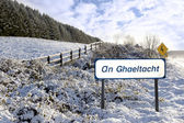 An ghaeltacht sign in irish snow scene — Stock Photo