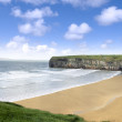 View over the beach and cliffs in Ballybunion — Stock Photo #21357505