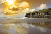 Ballybunion beach and cliffs wth Atlantic sunset — Stock Photo