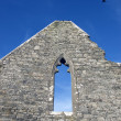 Ancient old arched window — Stock Photo