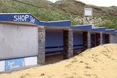 Boarded up seaside shop front — Стоковое фото