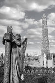 Archangel gravestone and Ancient round tower — Stock Photo