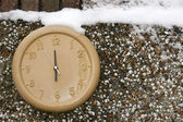 Clock on a wall in the winter season — Stock Photo