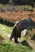 Woman on a walk at pilgrimage site — Stock Photo