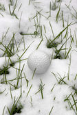 Single dimpled golf ball in the snow — Stock Photo