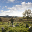 Female tourist at a stone circle in county Donegal — Stock Photo