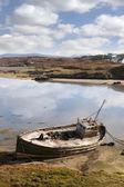 Old fishing boat beached on Irish beach — Stock Photo