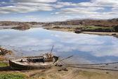 Old beached fishing boat on Irish beach — Stock Photo