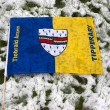 Tipperary flag against grass and snow — Stock Photo