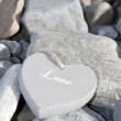 Inscribed love heart on the rocks — Stock Photo