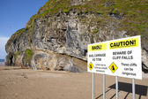 Ballybunion beach cliff falls warning sign — Stock Photo