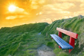Bench on a cliff edge at sunset — Foto de Stock