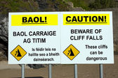 Beware of cliff falls warning sign — Stock Photo