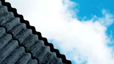 Clouds rushing over house roof — Wideo stockowe