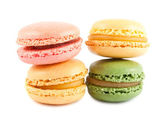 Four colorful french macaroons — Stock Photo