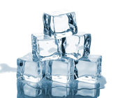 Six ice cubes with reflection — Stock Photo