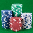 Poker chips on green playing table — Stock Photo