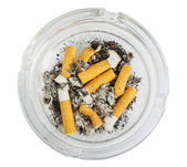 Stubs in glass ashtray top view — Stock Photo