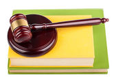 Wooden gavel on books — Stock Photo